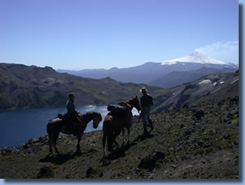 Riders in front of Villarrica, on the Crossing the Andes on Horseback in Northern patagonia Trail