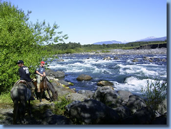Riders on the banks of Trancurs river on a half day ride in Pucon, Chile