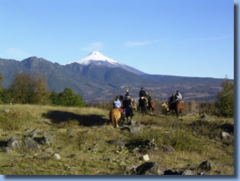 Riders in front of Villarrica volcano on a half day ride in Pucon, Chile