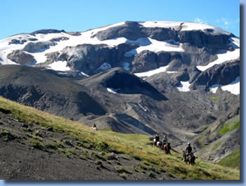 Group of riders in front of a mountain on Sollipulli horse back  trek in the Andes