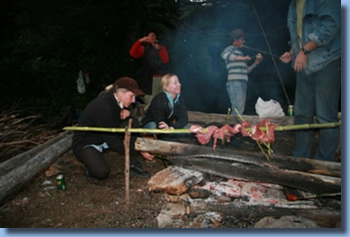 group around a BBQ and campfire on a trailriding for beginners program.