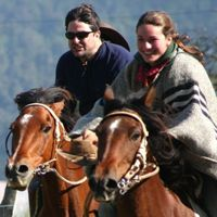 Edward and lena racing their horses  on a trailride crossing the Andes riding both Chile and Argentina